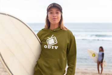 pullover-hoodie-mockup-of-a-woman-with-a-surfboard-standing-against-beach-waves-26818.png